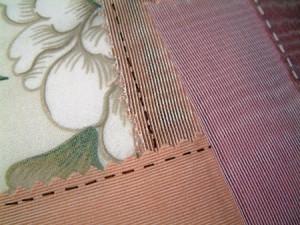 Close up of drawn on stitching