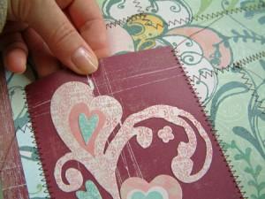 Scrapbook page stitched pocket