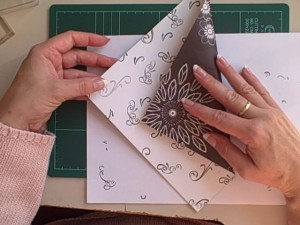 Use stamping to make scrapbook paper double sided